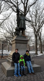 The boys in front of the Columbus statue