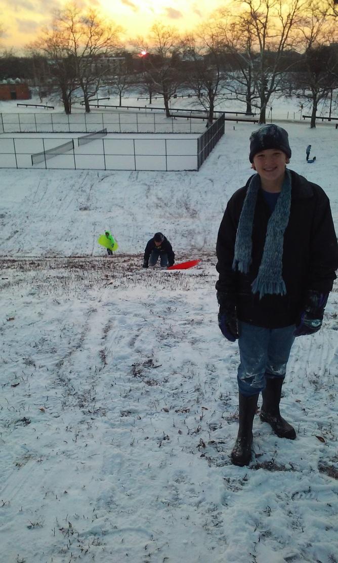 The boys climbing the snow hill