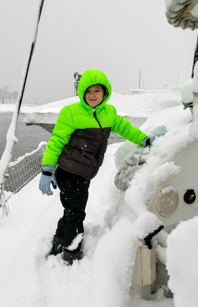 Erik playing on our snowy boat