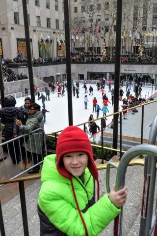 Erik watching the ice skaters