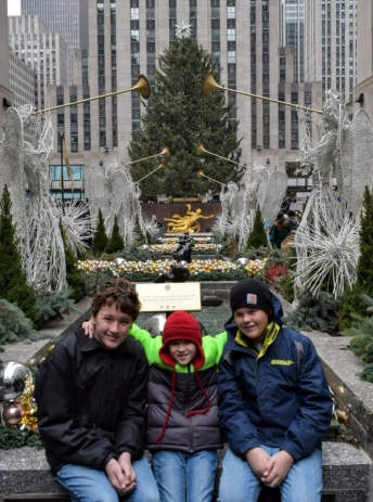 The boys in front of the tree