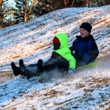 Liam and Erik sledding