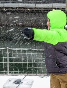 Erik throwing snowballs