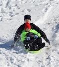 Liam and Erik kicking up snow